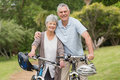Senior couple on cycle ride at the park Stock Photography