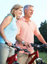 Senior couple cycling Royalty Free Stock Photos