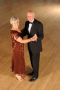Senior couple in dance pose Royalty Free Stock Photo