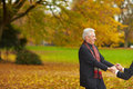 Senior couple dancing in a park Stock Image