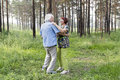 Senior couple dancing in a summer forest Royalty Free Stock Photo