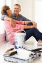 Senior couple decorating house Royalty Free Stock Images