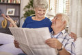 Senior couple discussion about recent news Royalty Free Stock Photo