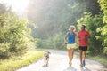 Senior Couple With Dog Running...