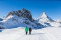 image photo : Senior couple doing winter hiking near Matterhorn, Zermatt