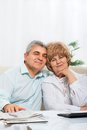 Senior couple dream smile sitting on sofa at home living room Royalty Free Stock Photos
