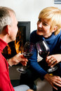 Senior couple drinking red wine Stock Images