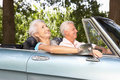Senior couple driving in a sports car Royalty Free Stock Images