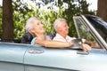 Senior Couple Driving In A Spo...