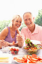 Senior couple eating outdoors Royalty Free Stock Photo
