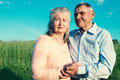 Senior couple embracing each other in countryside happy outdoors Stock Photography