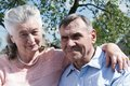 Senior couple embracing each other in countryside spring happy outdoors Stock Photos