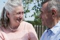 Senior couple embracing each other in countryside spring happy outdoors Royalty Free Stock Photography