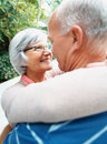 Senior couple embracing each other outdoors Royalty Free Stock Image