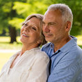 Senior couple embracing in nature caucasian Royalty Free Stock Photos