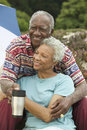 Senior couple embracing outdoors relaxed smiling Royalty Free Stock Photos