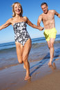 Senior Couple Enjoying Beach Holiday Royalty Free Stock Photography