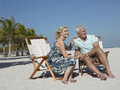 Senior Couple Enjoying Beach Vacation Stock Images
