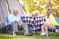 Senior couple enjoying camping holiday in countryside Stock Image