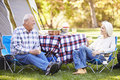 Senior couple enjoying camping holiday in countryside Stock Photography
