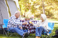 Senior couple enjoying camping holiday in countryside Stock Images
