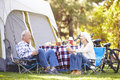 Senior couple enjoying camping holiday in countryside Royalty Free Stock Image