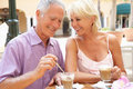 Senior Couple Enjoying Coffee And Cake Stock Photo