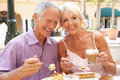 Senior Couple Enjoying Coffee And Cake Stock Photos