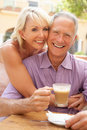 Senior Couple Enjoying Coffee And Cake Royalty Free Stock Image