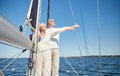 Senior couple enjoying freedom on sail boat in sea sailing age tourism travel and people concept happy or yacht deck floating Stock Photography