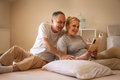 Senior couple enjoying at home and reading book. Royalty Free Stock Photo
