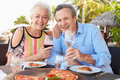 Senior couple enjoying meal in outdoor restaurant smiling Royalty Free Stock Image