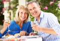 Senior Couple Enjoying Meal outdoors Royalty Free Stock Photography