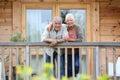 Senior couple enjoying peaceful holidays in wooden cabin