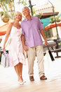 Senior Couple Enjoying Shopping Trip Royalty Free Stock Photography
