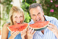 Senior Couple Enjoying Slices Of Water Melon Royalty Free Stock Photography