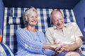 Senior couple enjoying summer in garden retirement Stock Image
