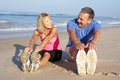 Senior Couple Exercising On Beach Royalty Free Stock Photography