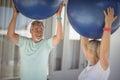 Senior couple exercising with exercise ball Royalty Free Stock Photo
