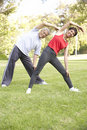 Senior Couple Exercising In Park Royalty Free Stock Image