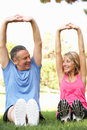 Senior Couple Exercising In Park Royalty Free Stock Photography