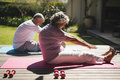Senior couple exercising together at porch Royalty Free Stock Photo