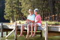 Senior couple fishing together Royalty Free Stock Photo