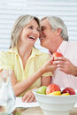 Senior couple flirting at breakfast Stock Photography