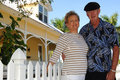 image photo : Senior couple in front of house