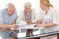 Senior couple getting financial consultation from insurance woman Royalty Free Stock Images