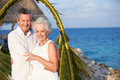 Senior couple getting married in beach ceremony smiling to camera Royalty Free Stock Photo