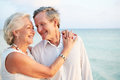 Senior couple getting married in beach ceremony walking along Royalty Free Stock Photography