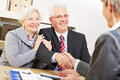 Senior couple giving handshake to consultant for a greeting Stock Photography