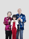 Senior couple and granddaughter portrait of a chinese their Royalty Free Stock Photos